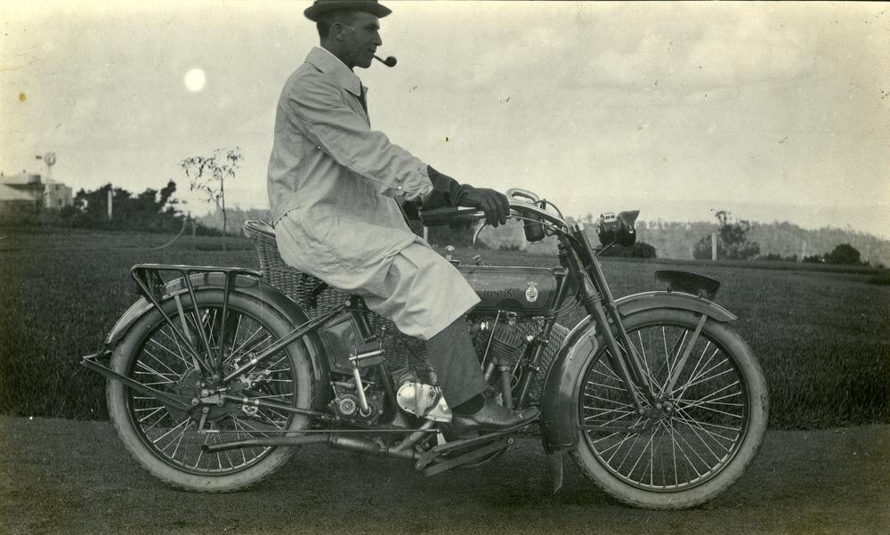 motorcyclist wearing driving gloves and duster 1910s