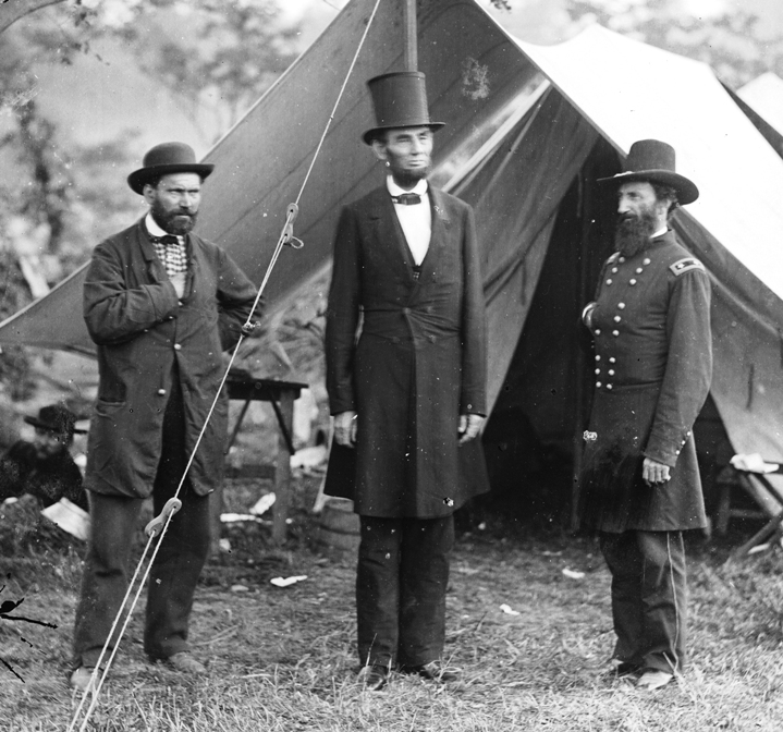 Abraham Lincoln (middle) in his stovepipe silk hat at Antietam, 1862