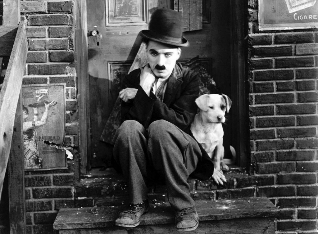 Charlie Chaplin in bowler hat, a still for his 1915 film, The Tramp