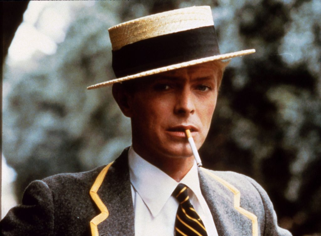 David Bowie in boater hat. Publicity still for Merry Christmas, Mr. Lawrence (1983)