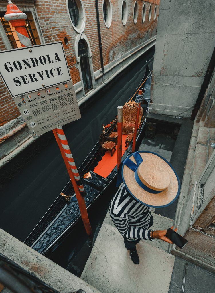 Venice Gondolier wearing a boater hat, photo by Clay Banks