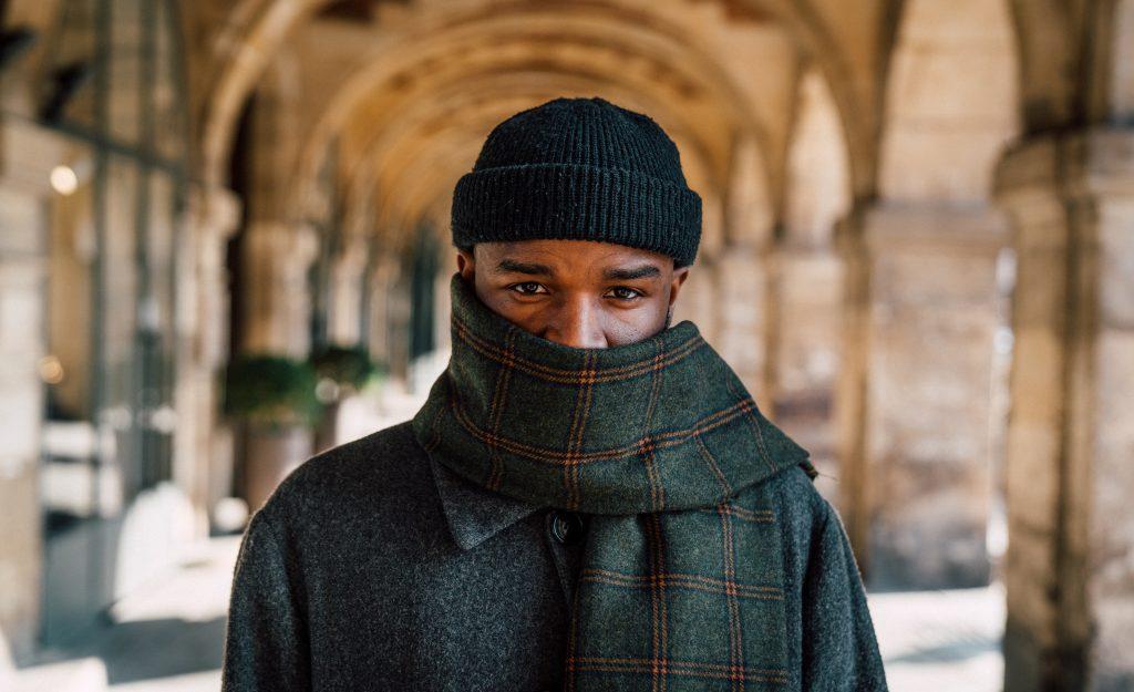 A French man in beanie, photo by Jilbert Ebrahimi